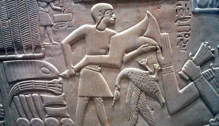 man-offering-foreleg-ox-hieroglyph-egyptian