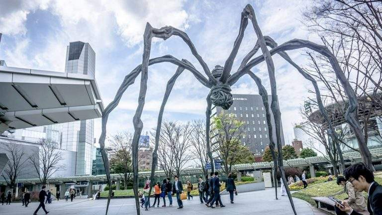 large spider sculpture in an open public space