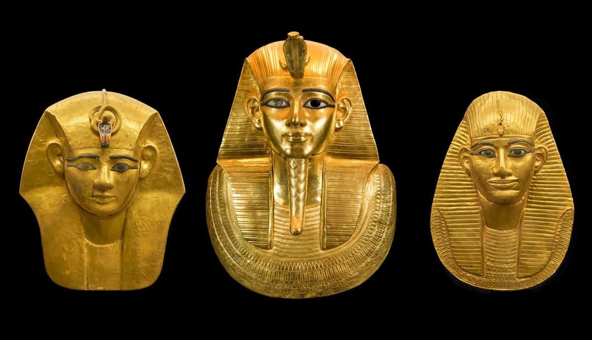 three_egyptian_gold_mummy_masks_of_phara